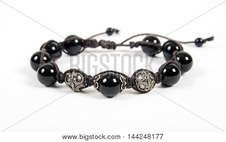Popular Buddhist bracelet shamballa on a white background.