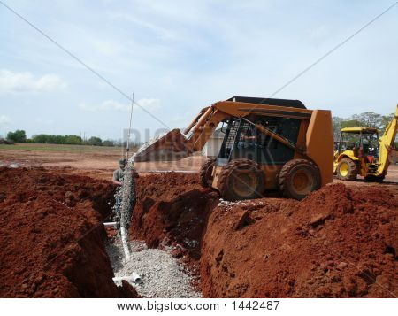 Pouring Rock Into Anerobic Septic System