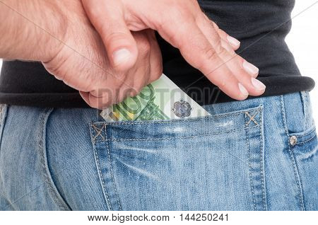 Close-up Of Human Hands Putting Money