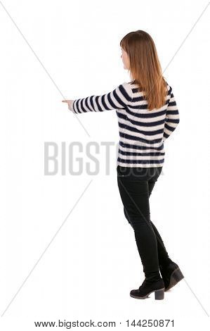 Back view of  pointing woman. beautiful girl. Rear view people collection.  backside view of person.  Isolated over white background. Girl in a striped jacket stands sideways and presses his finger on