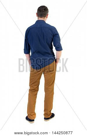 Back view of man . Standing young guy. Rear view people collection.  backside view of person.  Isolated over white background. a man in a blue shirt with the sleeves rolled up, standing with his hands
