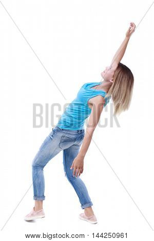 Balancing young woman.  or dodge falling woman. Rear view people collection.  backside view of person.  Isolated over white background. The blonde in a blue shirt and jeans leaned back heavily.