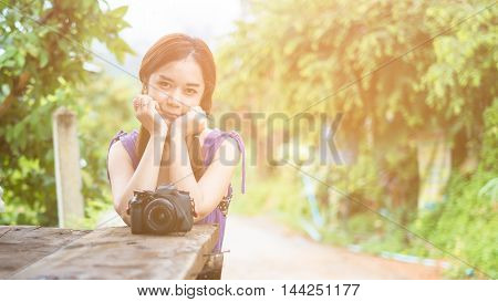 Portrait of young woman photographer in the park
