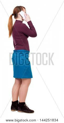 back view of a woman talking on the phone.  backside view of person.  Rear view people collection. Isolated over white background. Girl with red hair tied in a ponytail and white talking on a
