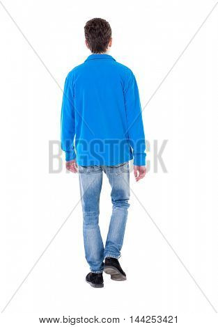 Back view of going  handsome man. walking young guy . Rear view people collection.  backside view of person.  Isolated over white background. Curly boy in blue sweater goes out of frame.