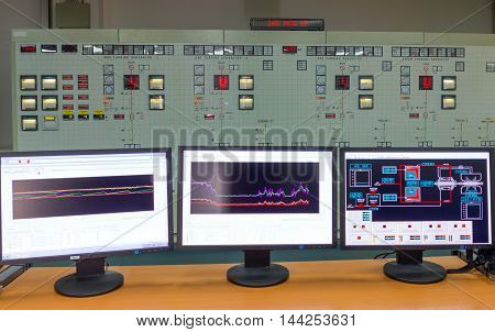 Monitors in a control room of a natural gas power plant