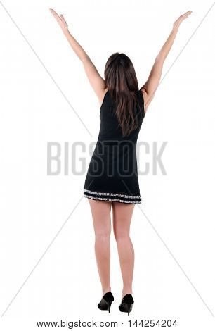 Woman with  hands lifted upwards. Rear view. Isolated over white.