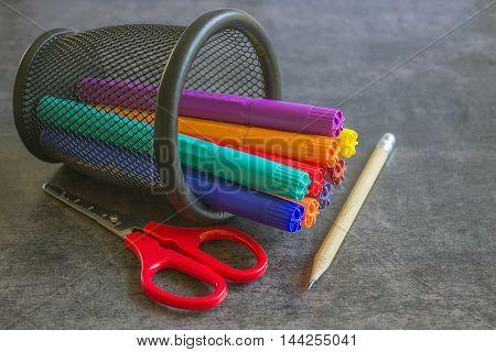 Bright markers scissors pencil. Concept - shopping for school.