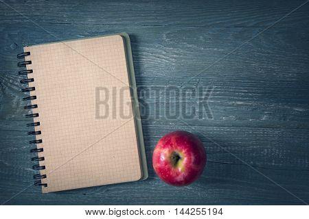 School supplies on a wooden background