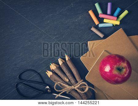 School supplies on a black background