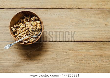Homemade Oatmeal Granola In Wooden Bowl