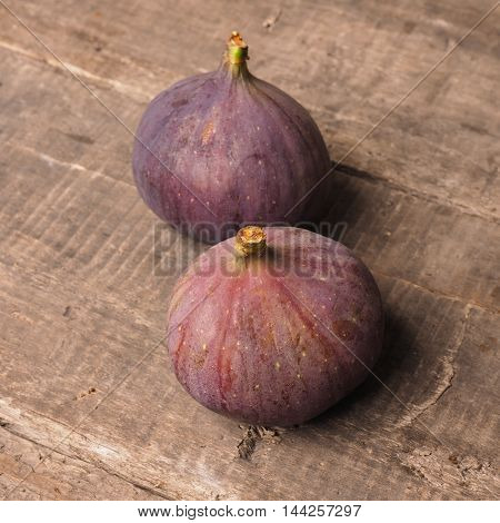 Fresh organic figs on a rustic wooden table healthy food concept