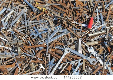 Old dirty rusty wrenches industrial tools pile