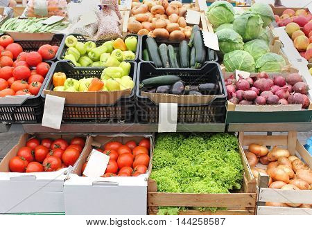 Fresh organic vegetables in crates on market stall