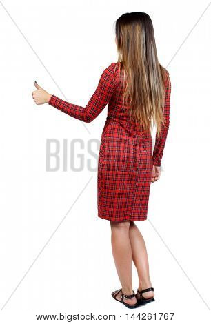 Back view of woman thumbs up. girl in red plaid dress shows thumb up.