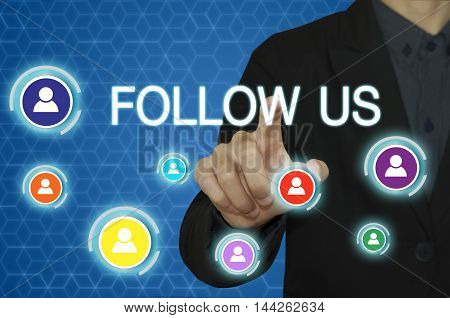 businessman hand working with modern computer and pressing follow us button.