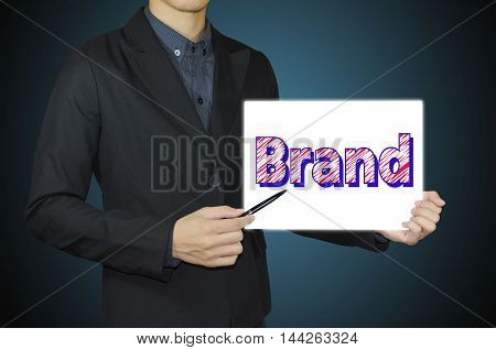 businessman hand showing white board and marketing brand concept.