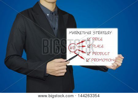 businessman hand showing white board and marketing strategy concept.