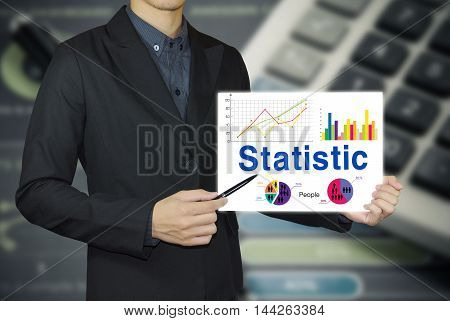 businessman hand showing white board and statistic graph concept.