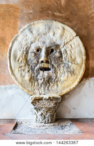 Rome Italy. The Mouth of Truth (La Bocca della Verita) carved from Pavonazzo marble in the portico of the church of Santa Maria in Cosmedin.