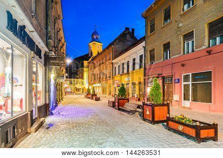 BRASOV ROMANIA - 5 JULY 2015: Morning twilight view with medieval downtown of Brasov main touristic city of Transylvania Romania.