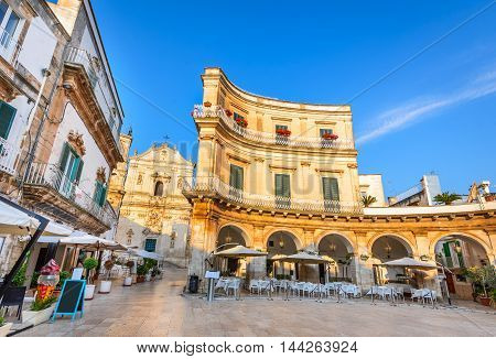 Martina Franca Puglia. Piazza Plebiscito and Basilica di San Martino. Landmark of Apulia at sunset light Italy.