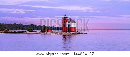 The Historic Round Island Lighthouse just after sunset as seen ferrying back to Mackinac City from Mackinac Island Michigan's Lower Peninsula USA