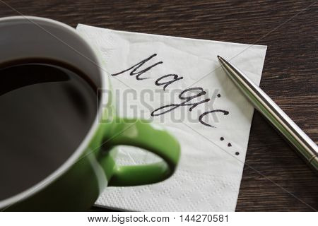 Coffee cup and napkin with message