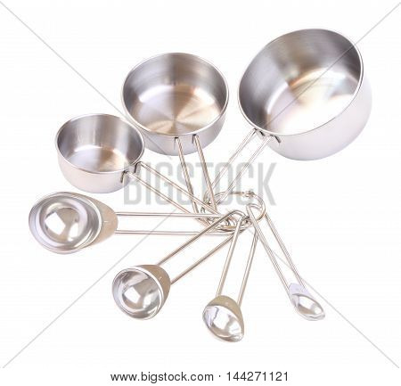 Series of stack measuring spoons on white background.
