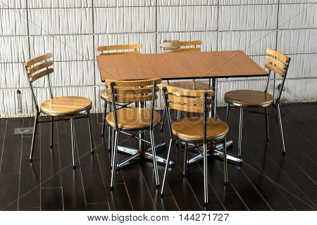 Disorderly lunch table and chair after use.