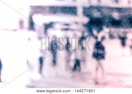 City commuters. High key blurred image of workers going back home after work. Unrecognizable faces, bleached effect.