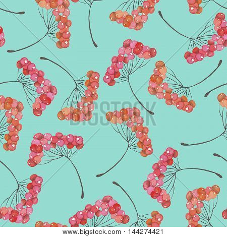 A seamless pattern with a floral ornament of the watercolor rowan tree branches, hand drawn on a blue background