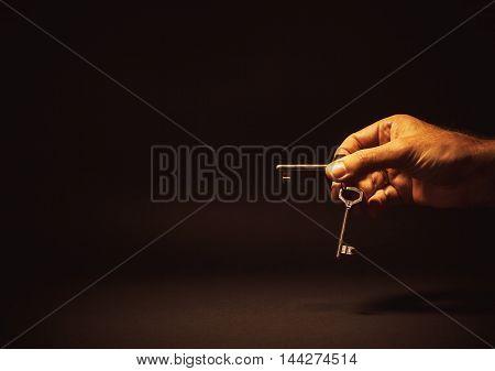 Male Hand Holding Keys