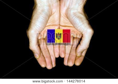 Flag Of Moldova In Hands On Black Background