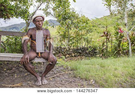 Baliem Valley West Papua Indonesia February 15th 2016: Dani tribe man smoking