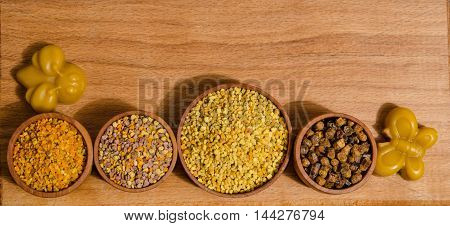 variety of bee products on wooden table