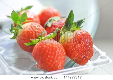 strawberry or some strawberies in the box