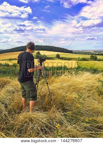Man taking panoramic landscapes in Sudety Range, Poland