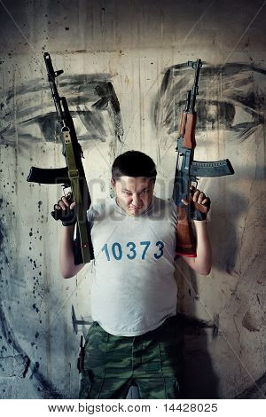 Mercenary With Two  'kalashnikov' Submachine Guns