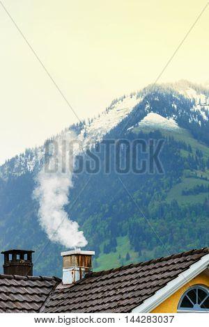 Smoke Raising From Chimney In Winter