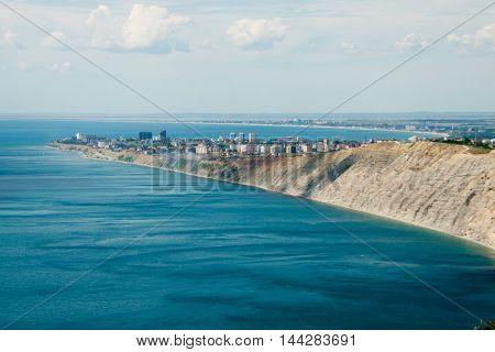 nice view from the mountains to the city and the sea with clouds summer day