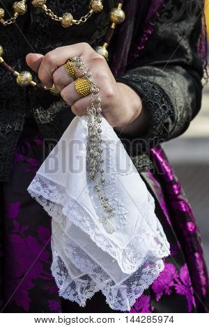 CAGLIARI, ITALY - May 1, 2015: 359 ^ Religious Procession of Sant'Efisio - Sardinia - detail of a lace handkerchief handheld by a girl in Sardinian costumes
