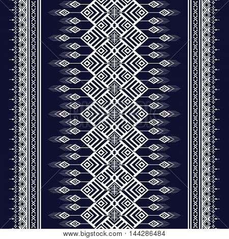 Dark blue and white sometric Ethnic pattern design for background or wallpaper.