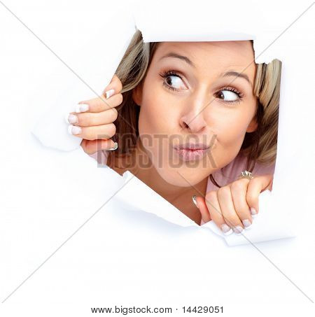 Cute young thinking woman  looking through a hole