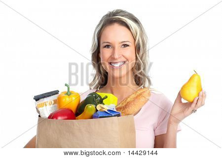 smiling young woman holding a shopping bag with food