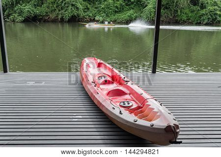 Canoe Boat On Raft Near The River In Thailand