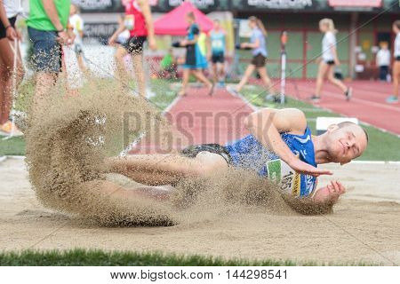 KAPFENBERG, AUSTRIA - AUGUST 8, 2015: Martin Schwingenschuh (#165 Austria) participates in the national track and field championship.