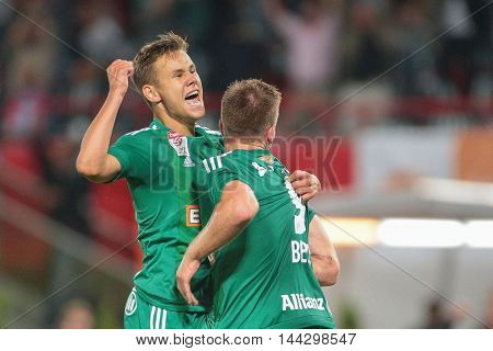 VIENNA, AUSTRIA - JULY 29, 2015: Louis Schaub (SK Rapid) and Robert Beric (SK Rapid) celebrate a goal in an UEFA Champions League qualification game.