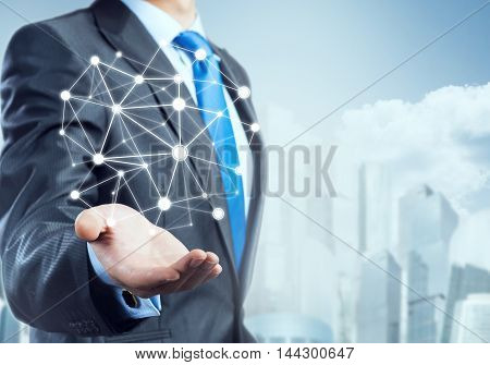 Businessman hand showing digital connection lines on city landscape