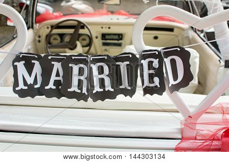 Just Married Note Hanging From The Car Seat